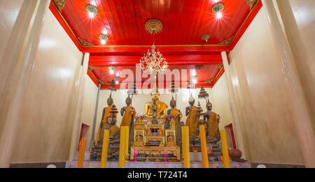 SAMUT SAKHON, THAILAND - SEPTEMBER 25: Interior of Thai temple with Buddha statues and altar on September 25,2015 in Wat Yai Ban Bo. - Stock Photo