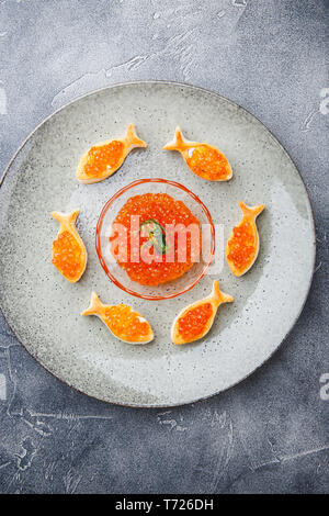 Delicious appetizer with red caviar. - Stock Photo