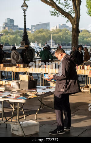 London, UK. The Southbank Centre Book Market on Queen's Walk beneath Waterloo Bridge, a daily outdoor market for secondhand books - Stock Photo