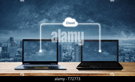 Computer laptops sharing data through cloud storage computing. Cloud computing and computer network concepts - Stock Photo
