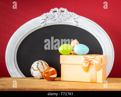 Easter decoration gift box eggs and vintage frame - Stock Photo
