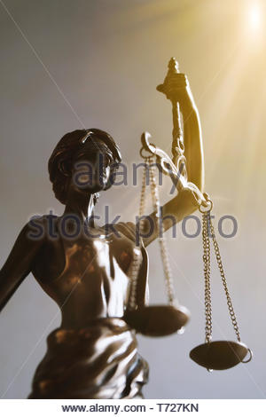 lady justice or justitia figurine law and legal symbol - Stock Photo