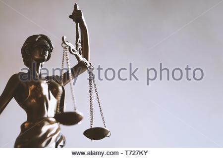 lady justice or justitia figurine - law and jurisprudence symbol - Stock Photo