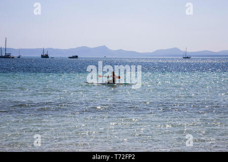 A kayaker on the sea in Port d'Alcudia, Mallorca, Spain. - Stock Photo