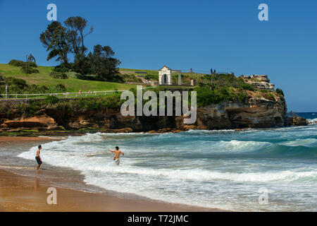 The Bondi beach to Coogee walk is a coastal walk in Sydney New South Wales, Australia. People in Coogee beach Dolphins Point and Giles Baths - Stock Photo