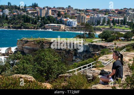 The Bondi beach to Coogee walk is a coastal walk in Sydney New South Wales, Australia. Tourist near Gordons Bay. - Stock Photo