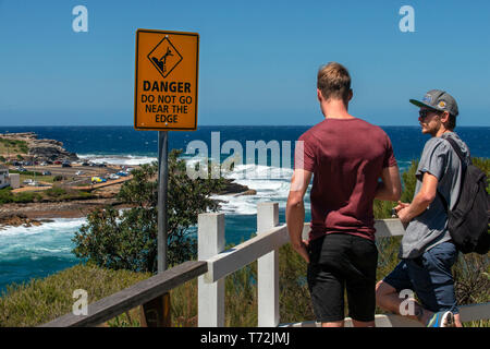 The Bondi beach to Coogee walk is a coastal walk in Sydney New South Wales, Australia. Tourists near Gordons Bay. - Stock Photo