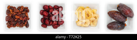 Various dried fruits in white bowls in top view - Stock Photo