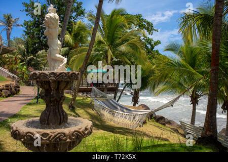 Hammock and fountain at Casa Canada hotel on Big Corn Island, Nicaragua, Central America - Stock Photo
