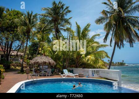 Infinity pool an palm tree at Casa Canada hotel on Big Corn Island, Nicaragua, Central America - Stock Photo