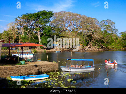 Isletas de Granada, islands in Lake Nicaragua with private home and boaters  Central America. The islands range from a few feet across up to more than - Stock Photo