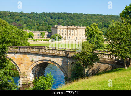 Chatsworth House park with an entrance bridge over the river Derwent parkland and woods Derbyshire England UK GB,  Europe - Stock Photo