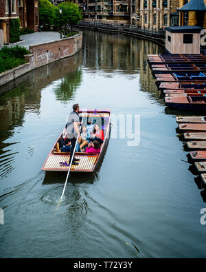 Cambridge Tourism - tourists take a punt along the River Cam in central Cambridge UK - Cambridge Punting - Stock Photo