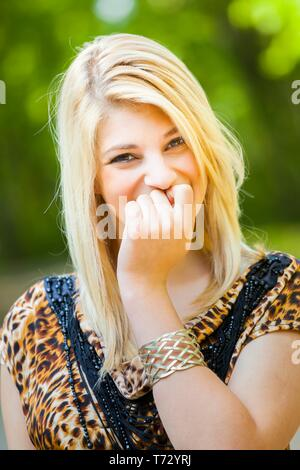 Shy blonde teen girl beauty - Stock Photo