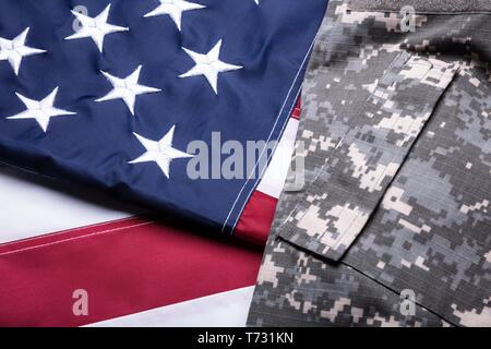 Close-up Of Military Uniform On American National Flag - Stock Photo