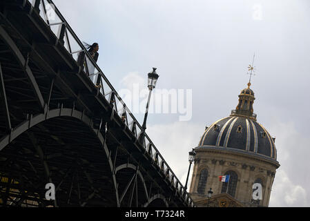Pont des Arts bridge across the river Seine in the city centre of Paris - Stock Photo