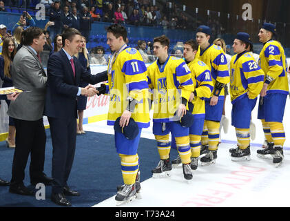 KYIV, UKRAINE - APRIL 20, 2018: Team of Ukraine, the winner of the IIHF 2018 Ice Hockey U18 World Championship Div 1B. Medal ceremony at Palace of Spo - Stock Photo
