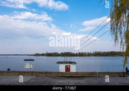Kyiv region , Ukraine - April 21, 2019: Quay of the Dnipro river in the city of Ukrainka, Kiev region, Ukraine - Stock Photo