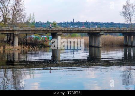 Kyiv region , Ukraine - April 21, 2019: The Bridge in the city of Ukrainka, Kiev region, Ukraine - Stock Photo