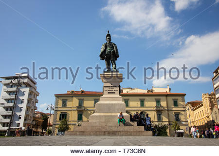 Pisa, Italy - May, 17, 2017: people sat around the bottom of the Monument to Vittorio Emanuele II on a bright hot sunny summer day - Stock Photo