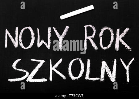 Colorful chalk drawing on a chalkboard: A New School Year, Polish text - Stock Photo