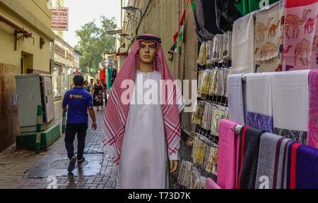 Dubai, UAE - Dec 6, 2018. Male mannequin in a traditional Arabic clothing at street market in Dubai, United Arab Emirates. - Stock Photo