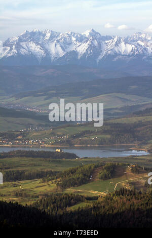 Distant Czorsztyn castle under majestic Tatra Mountains. - Stock Photo