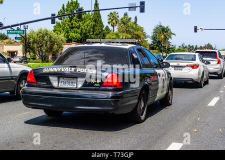 April 30, 2019 Sunnyvale / CA / USA - Police car driving on the streets of Sunnyvale, Santa Clara county - Stock Photo
