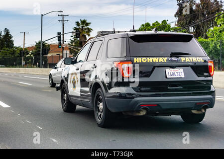 April 27, 2019 Redwood City / CA / USA - Police car driving on the freeway in East San Francisco bay area - Stock Photo