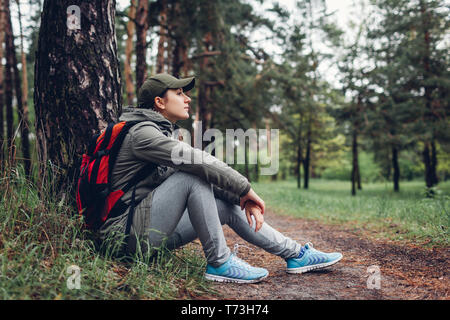 Woman tourist walking in spring forest. Close up of shoes. Sport, traveling and tourism concept
