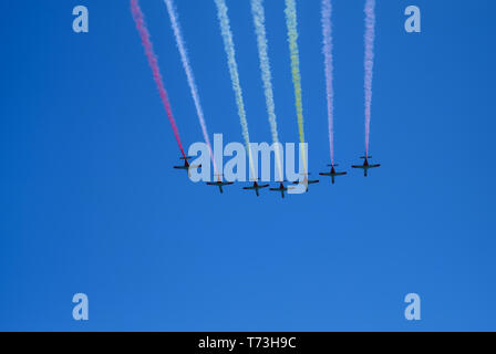 Torre del Mar, Spain - July 29, 2018. aircrafts aerobatic group drawing Spanish flag figure in the blue sky at Festival Aereo International Torre del  - Stock Photo