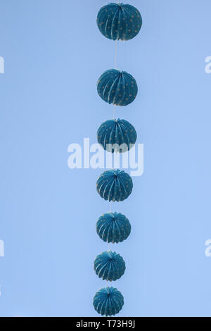 blue lampions on clear blue sky - Stock Photo