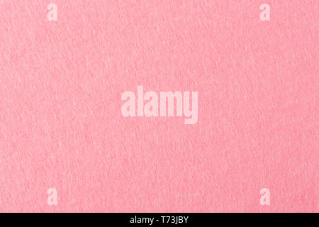 Close up detail view of a pink piece of textured felt fabric with rough touch. High resolution photo. - Stock Photo