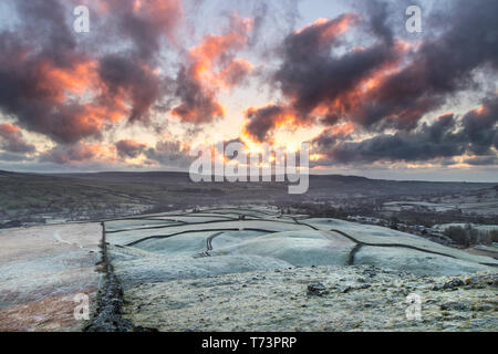 A Frosty Sunrise Viewed from the Ancient Tumulus of Kirkcarrion, Lunedale, Teesdale, County Durham, UK - Stock Photo