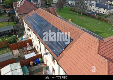 Drone view of solar panels on council house roof - Stock Photo
