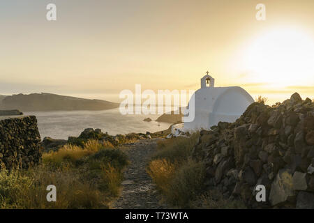 View from a hill near Oia with white chapel in the foreground Santorini, Greece - Stock Photo