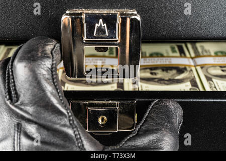 Black case full of dollar bills close up.Money bricks in case. - Stock Photo