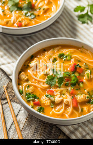 Homemade Thai Chicken Coconut Curry Pho with Cilantro - Stock Photo