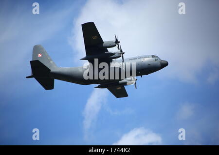 Poland: C-130 flight presentation during military parade on Constituion celebration day. - Stock Photo
