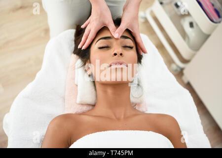 Woman receiving head massage in spa wellness center. - Stock Photo