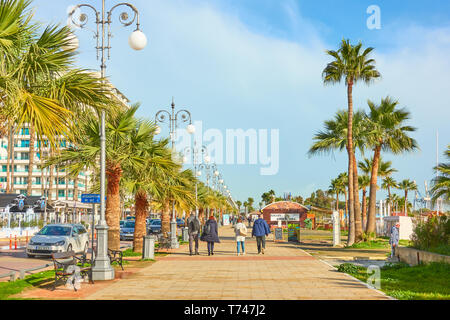Larnaca, Cyprus - January 28, 2019: Promenade next to Finikoudes beach with walking people in Larnaca - Stock Photo