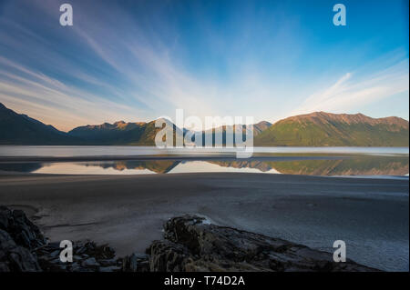 Alaska's Cook Inlet with bands of clouds looking like sun beams on a beautiful South-central Alaskan summer day; Alaska, United States of America - Stock Photo