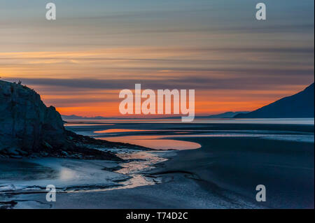 The setting sun over Alaska's Cook Inlet on a summer evening in South-central Alaskan; Alaska, United States of America - Stock Photo