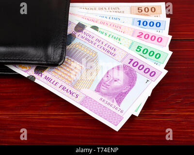 Central African money in the black wallet - Stock Photo