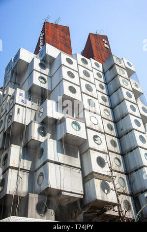 Tokyo, Japan - April 2019: Nakagin Capsule Tower Building, Chuo-Ku,  Built in 1972 and designed by Japanese architect Kisho Kurokawa - Stock Photo