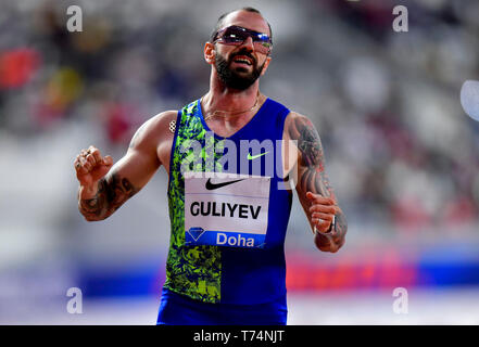 Doha, Qatar. 3rd May, 2019. Ramil Guliyev of Turkey celebrates after the men's 200m final at 2019 IAAF Diamond League at Khalifa International Stadium in Doha, Qatar, May 3, 2019. Ramil Guliyev won the gold medal with 19.99 seconds. Credit: Nikku/Xinhua/Alamy Live News - Stock Photo