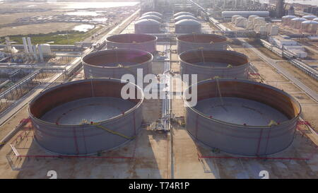 Bandar Seri Begawan, Brunei. 3rd May, 2019. Aerial view of giant oil tanks at Hengyi Industries' oil refinery and petrochemical plant at Pulau Muara Besar (PMB) in Bandar Seri Begawan, capital of Brunei, May 3, 2019. After the successful unloading of the first crude oil shipment on Thursday night, the oil refinery and petrochemical plant at Pulau Muara Besar (PMB), the biggest joint venture between China and Brunei, officially enters the stage of trial operation and production, Chen Liancai, CEO of Hengyi Industries said on Friday. Credit: Hengyi Industries/Xinhua/Alamy Live News - Stock Photo