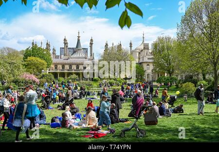 Brighton UK 4th May 2019 - Visitors enjoy the sunny but cool weather in Brighton Pavilion Gardens today with unsettled conditions forecast for the UK over the next few days. Credit: Simon Dack / Alamy Live News - Stock Photo