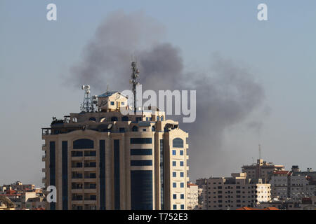 May 4, 2019 - Gaza City, Gaza Strip, 04 May 2019. Israeli aircrafts bomb the site of Abu Jarad, belonging to the Hamas movement, in the south of Gaza City. The attack is part of ongoing Israeli airstrikes carried out this Saturday in the Gaza Strip which came in response to dozens of rockets launched from Gaza into Israeli early on Saturday. The Israeli Defense Forces have targeted a number of military sites belonging to Hamas this Saturday as they view the Palestinian movement responsible for all incidents that take place in the Strip or come from it (Credit Image: © Ahmad Hasaballah/IMAGESL - Stock Photo