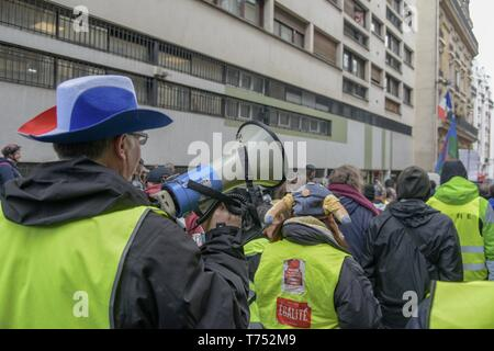 Paris, France. 04th May, 2019.The jilet jaunes march across Paris streets claiming against president Macron policies (Credit Image: © Maximiliano RamosZUMA Wire) Credit: ZUMA Press, Inc./Alamy Live News - Stock Photo